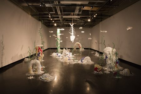 """""""Deep Sea Changes"""", 2018, Madeline Hildebrand  Plastic (HDPE - buckets, PET - bottles, straws, lids of bottles, containers, bags, wrappers, coffee lids, various packaging), chicken wire, fishing line, fishing accessories, and rope"""